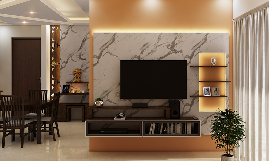 3bhk flat interior design with a cheerful living room with three-tier foyer unit