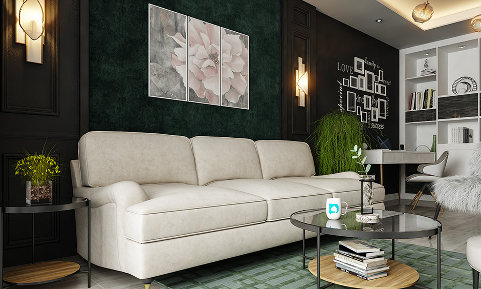 A frosty white club sofa unique living room chairs against a dark accent wall look elegant.