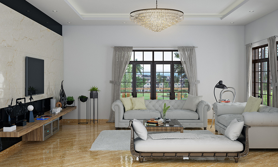 White living room seating idea classic white camelback sofa & cream coloured pillow gives a classic look.