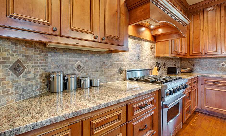 Vintage kitchen cabinet design wood with a light-toned varnish adds a great deal of warmth to this kitchen's interiors.