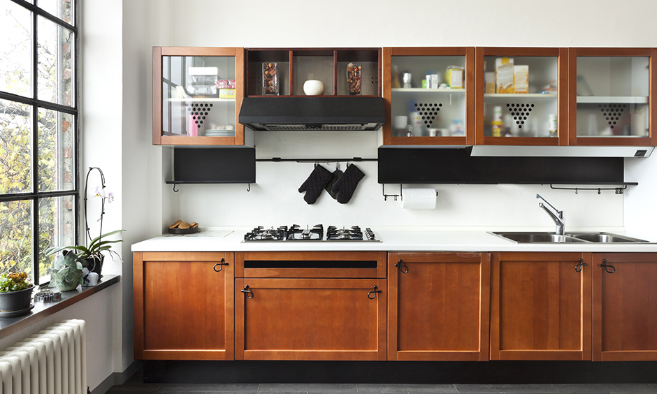 Stunning tan wood kitchen cabinets with a modern industrial touch look quite chic.