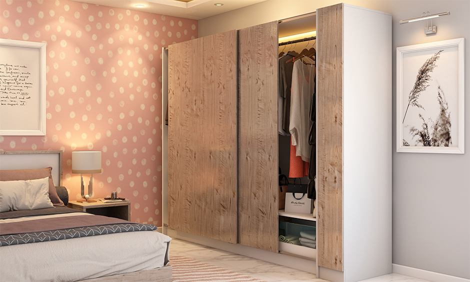 A sliding door wardrobe designs for bedroom indian which does not need too much maintenance