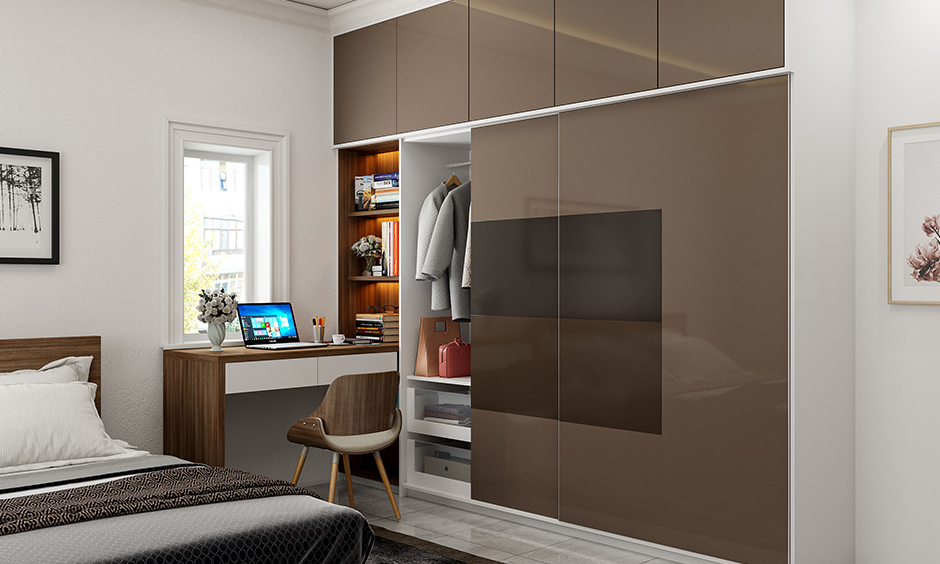 Contemporary sliding door wardrobe designs for bedroom with glossy laminate finish