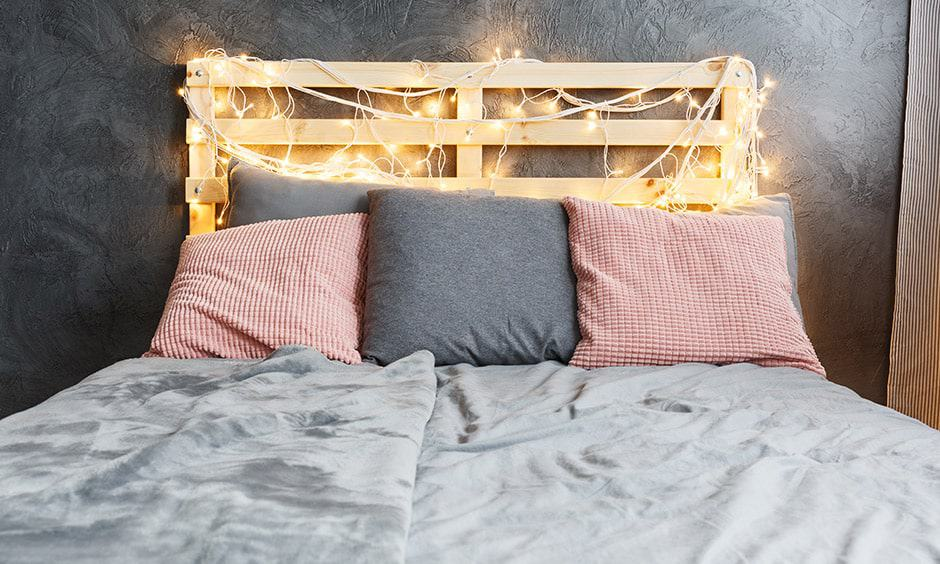 DIY headboard design with crates makes cosy vibe to this bedroom bed