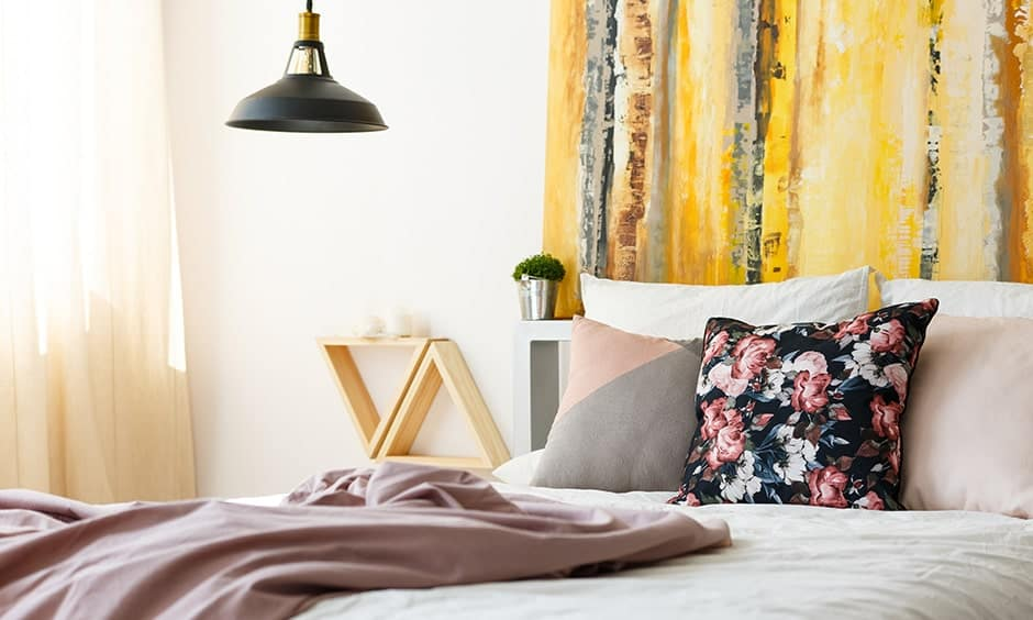 DIY headboard painting with a bold two-tone colour palette or a solid colour