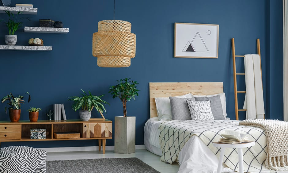 Bright bedroom colors with navy which makes a room feel cosier for bright room colors