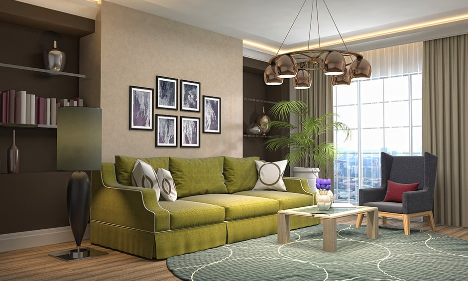 Olive green colour sofa in this bright brown shaded living room looks elegant.