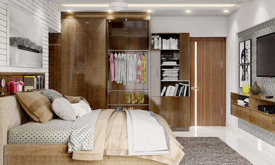 Wooden finish girls wardrobe design with a glass doors showcase of exquisite clothes looks aesthetics.