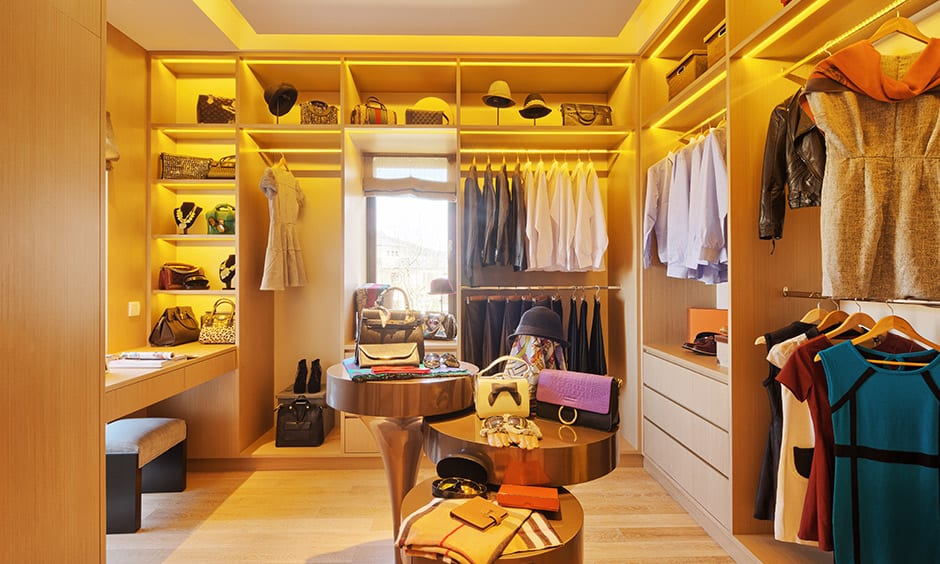 Modern wardrobe interior design for women with dressing table, plenty of storage & lightings is perfect