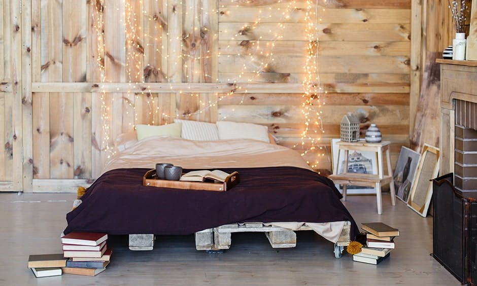 Romantic bedroom decorating ideas with a rustic touch decorated with fairy lights