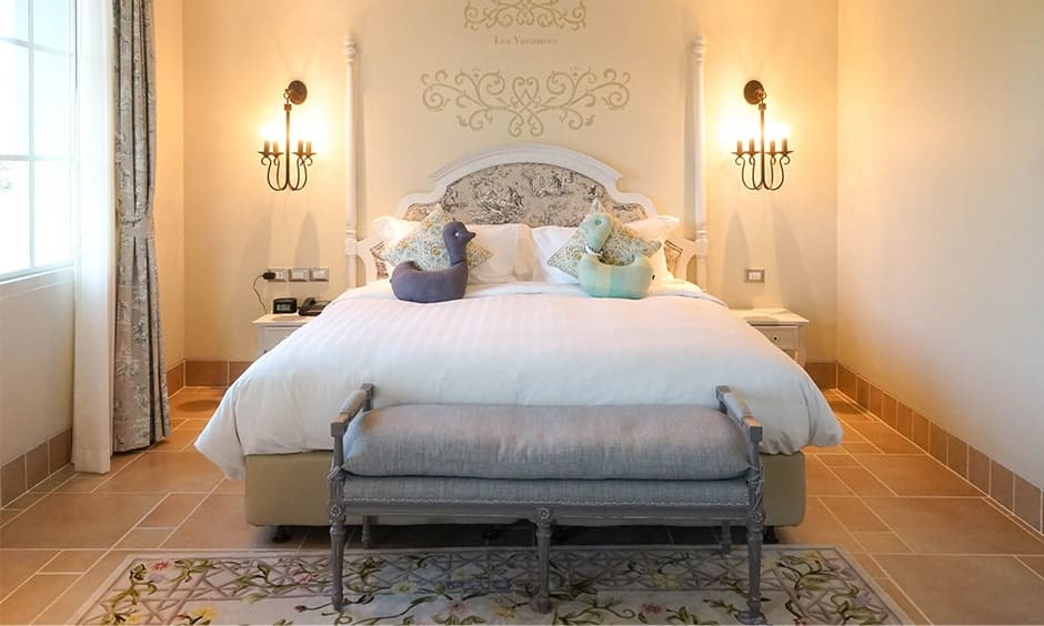 Romantic master bedroom decor with a candle-shaped light fixtures