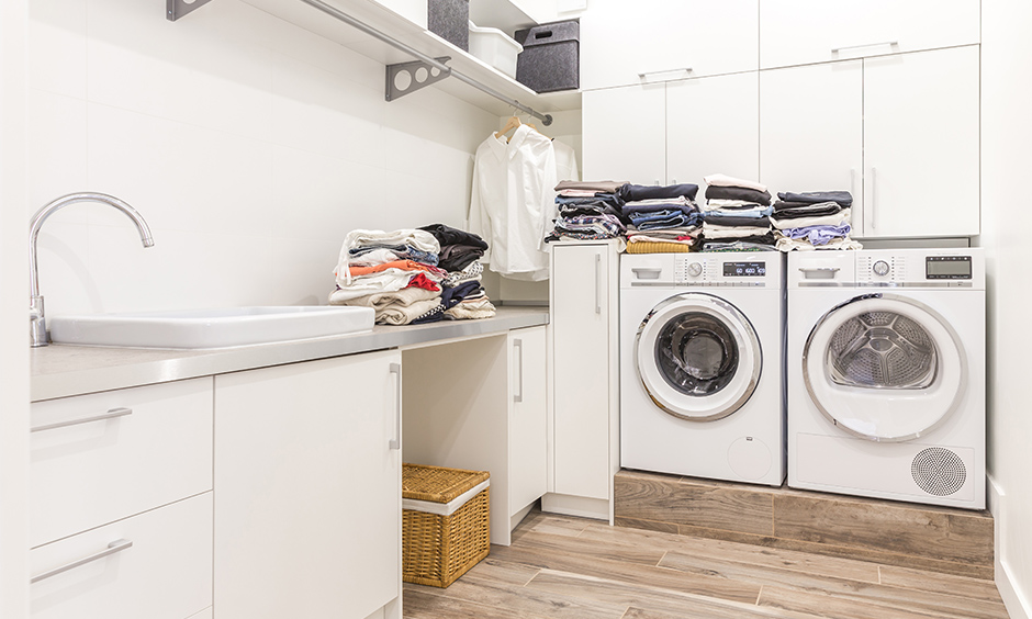 Laundry utility room design ideas add extra functionality to dead space utilising every nook with storage.