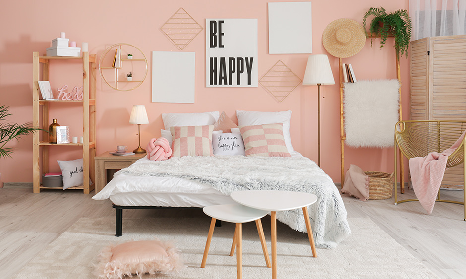 This master bedroom painted in light pink has a quirky and fun touch is light reflecting paint for dark rooms.