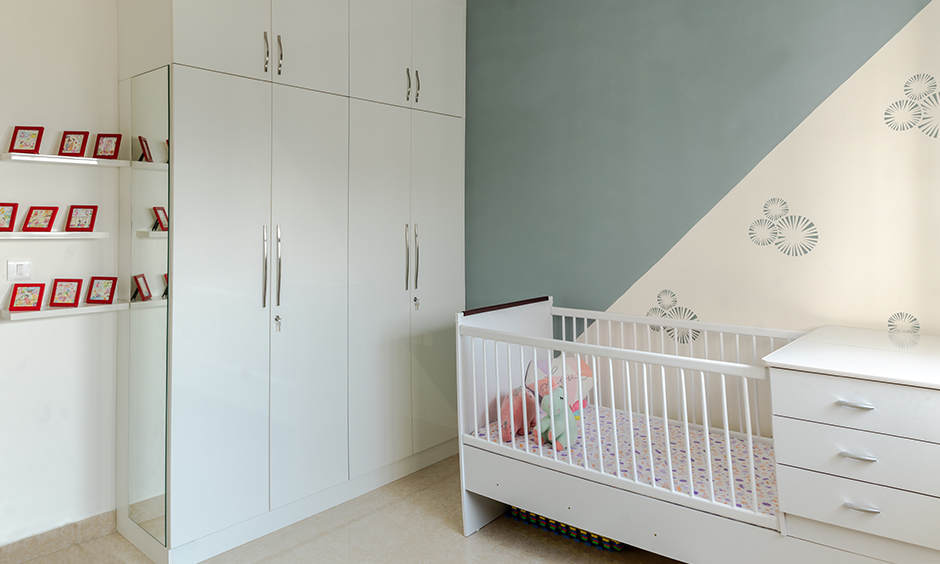 Design cafe designed this kids bedroom for prestige falcon city interior in Kanakapura road with glossy white laminate.