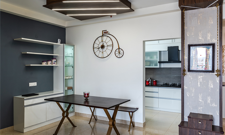 Interior designers in Kanakapura road designed this industrial style dining room with dark walnut dining table.
