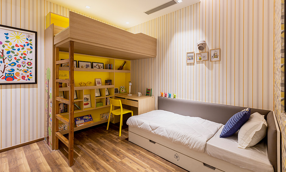Bunk bed with study unit & trundle bed with an L shaped grey headboard is interior design in Hyderabad for your home.