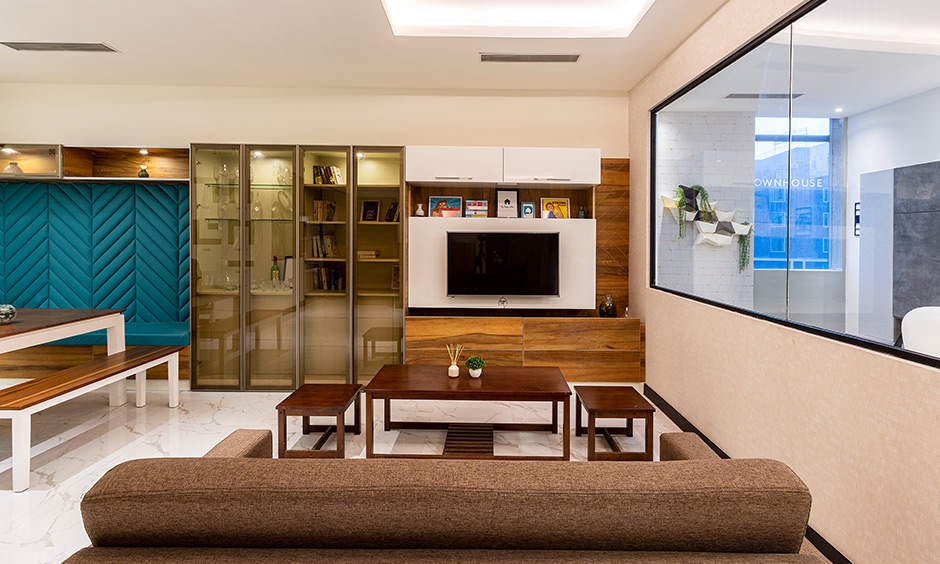 Living cum dining area with large window & tv unit combined with ample storage interior design services in Hyderabad.