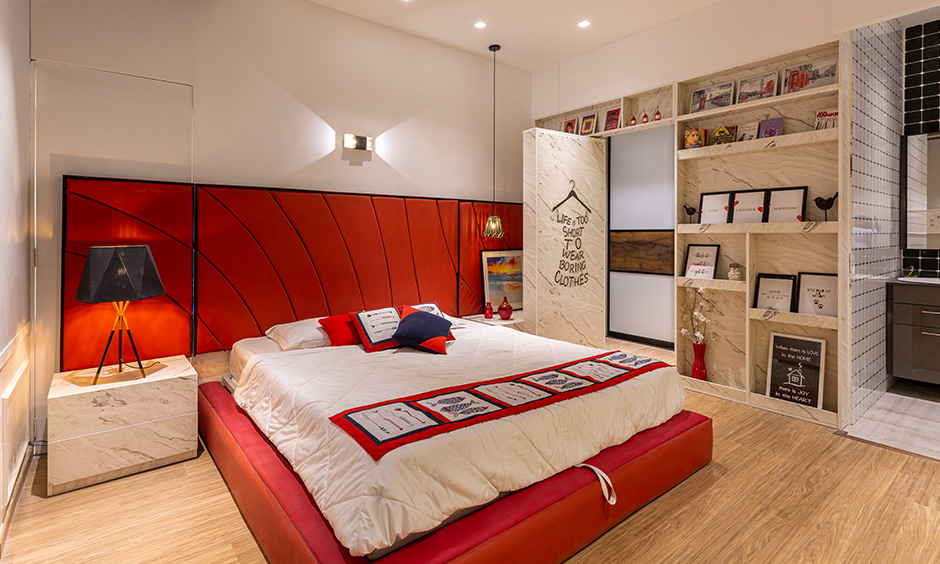Large headboard master bedroom in a bold modern lux theme with walk-in wardrobe is bedroom interior design in Hyderabad.