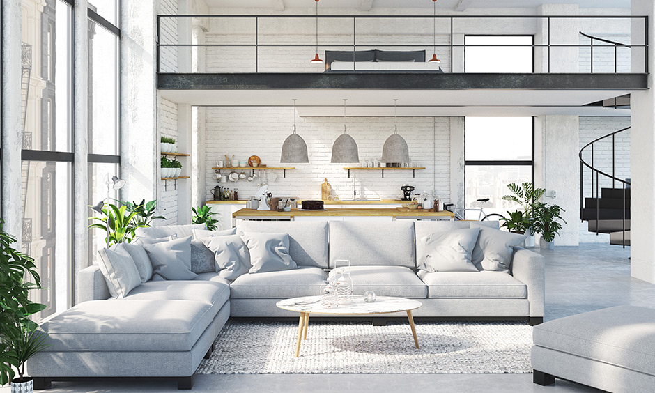 White living room with the sectional sofa in l-shaped, pillows & fur rug is simple family room decorating ideas.