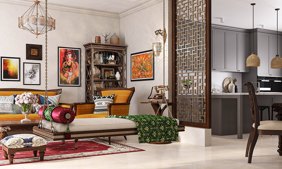 Add wall frames, lightings, red carpet, sofa with Indian weave and patterns are traditional family room decorating tips.