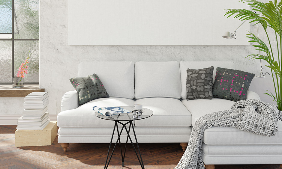 Small room sectional sofa in white coloured with pillows works great for a small family.