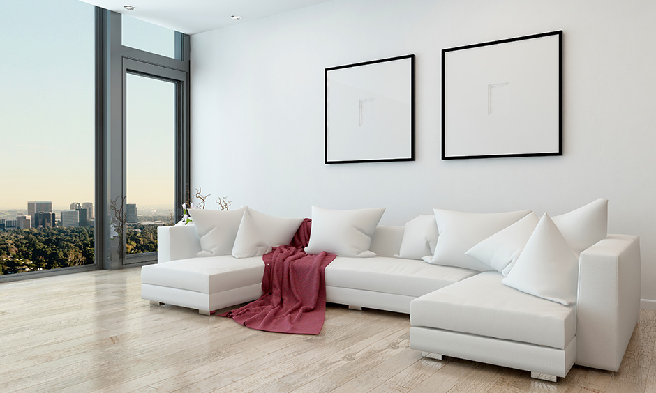 U-shaped designer sectional sofas in white coloured add aesthetics of your living room.