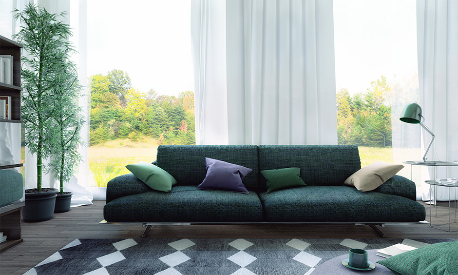 A wide compact sofa in green is perfect for tiny family & doubles up as a sofa bed are sectional sofa design ideas.