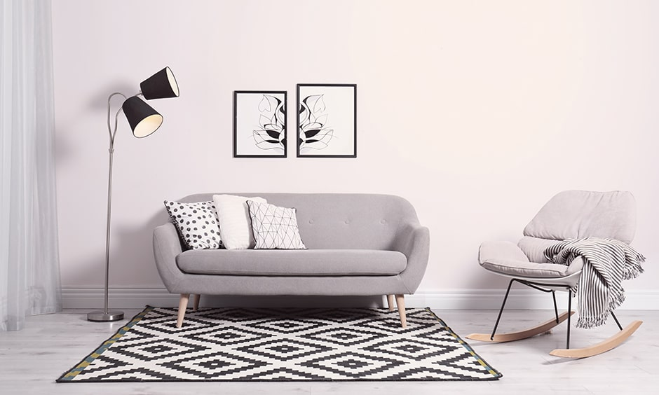 Living room seating with a sofa and a rocking chair