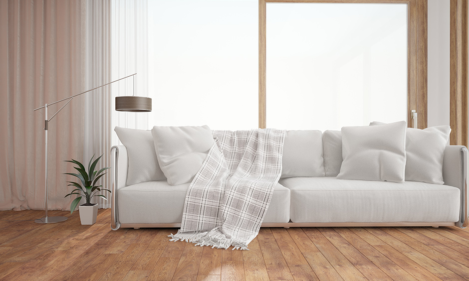 Low-height modern white fabric sofa brings home the farmhouse vibes to your living room.