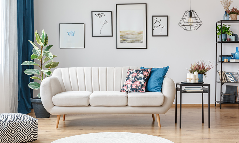 The mid-century modern white sofa is super easy to clean and can easily blend in every style and size of the living room.