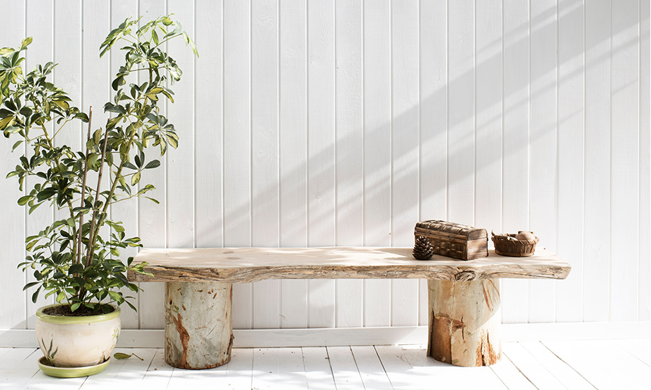 Patio seating made from reclaimed wooden logs outdoor is a modern farmhouse architecture DIY.