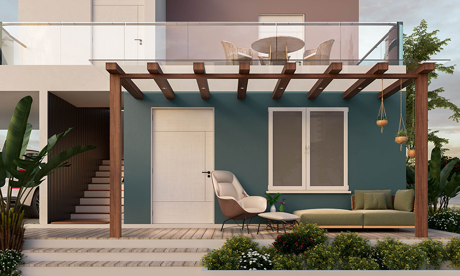 Modern farmhouse entry exterior designed with pergola, couch, and an armchair with a footrest is stunning.