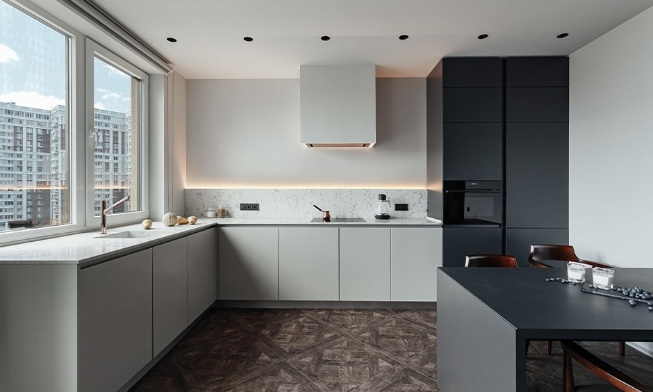 Black and white kitchen cupboards gives a glossy look modular kitchen