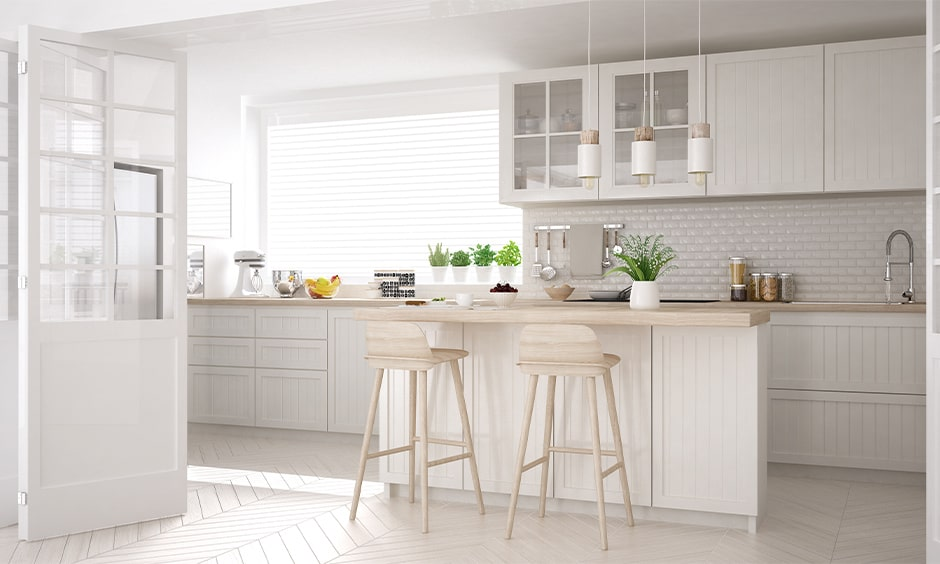 White wooden kitchen cupboards gives your interiors a traditional kitchen look
