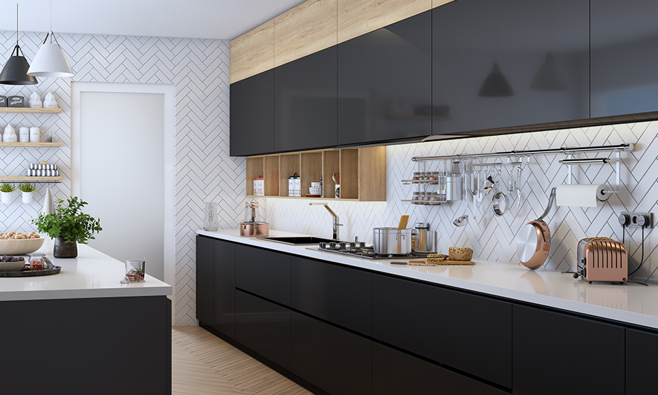 A black coloured modern parallel kitchen designs is one of the best parallel kitchen designs with a glossy finish and elegant look