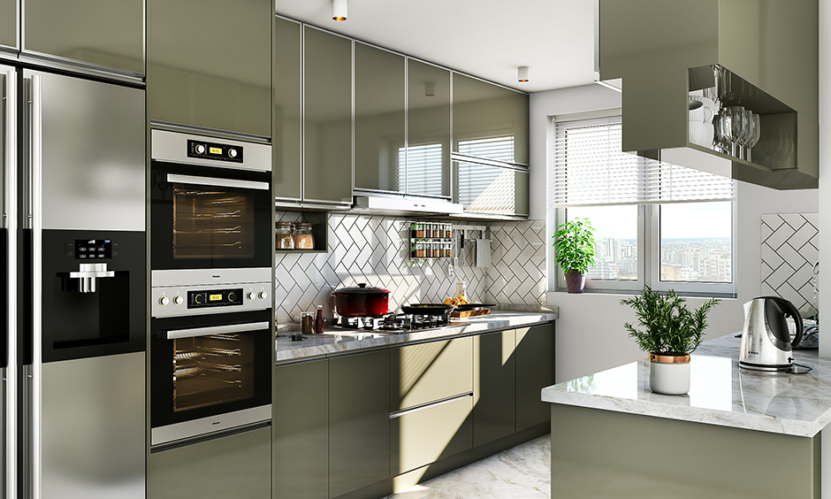 Indian parallel kitchen interior design with everything made up of stainless steel including cabinets, countertops and shelves