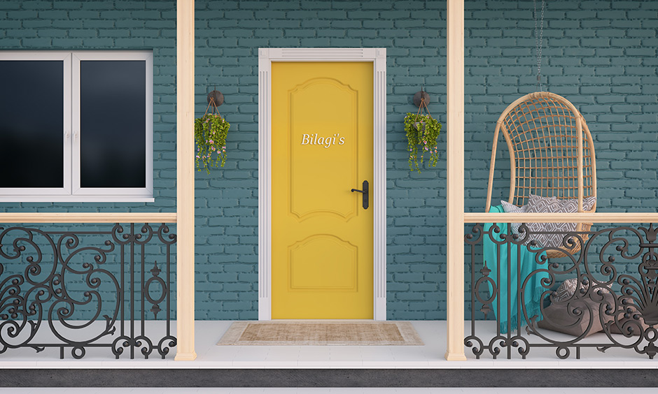 A navy exterior with the mustard yellow top on the front door creates a cohesive look and makes space look inviting.