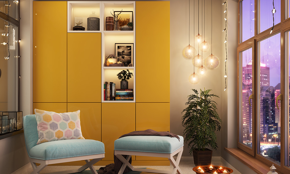 Mustard colour painted cupboard in this room with lightings and the indoor plant looks clean and clutter-free.