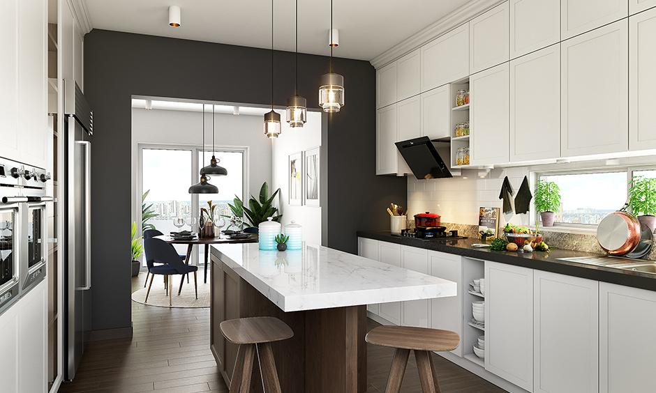 A white coloured spacious kitchen with wooden flooring with a island inside of a classic white parallel kitchen design