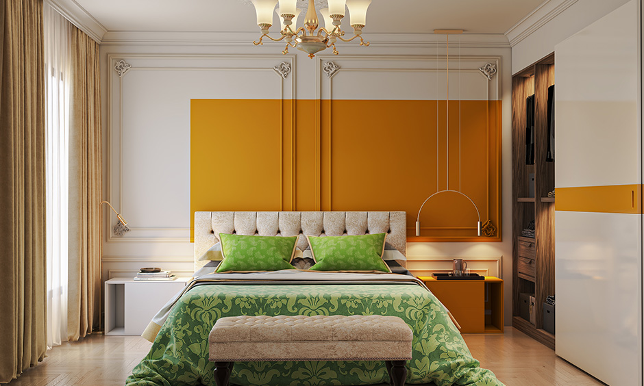 Bedroom with vivid shades of mustard color feature wall making a statement to home.