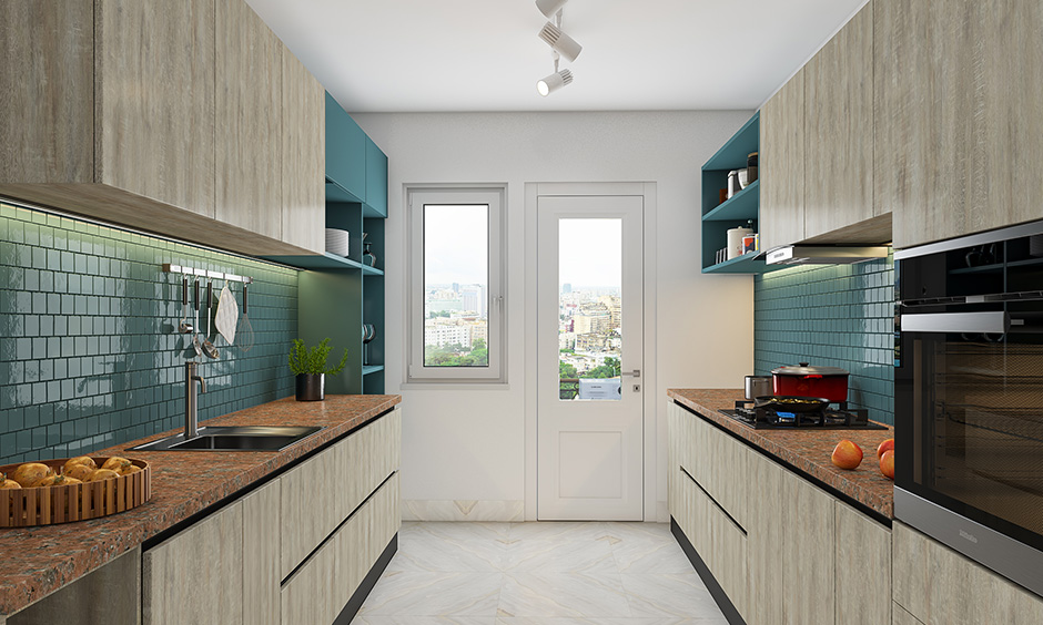 A minimalistic kitchen style of parallel modular kitchen designs in a U shape separated by sink