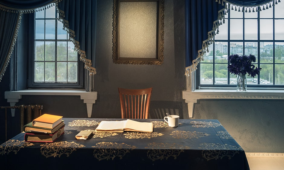 Classic study table decor idea with a rich tablecloth and golden coloured thread