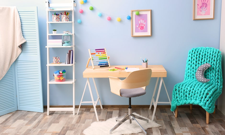 Kids room study table decoration idea with a wooden desk and chair
