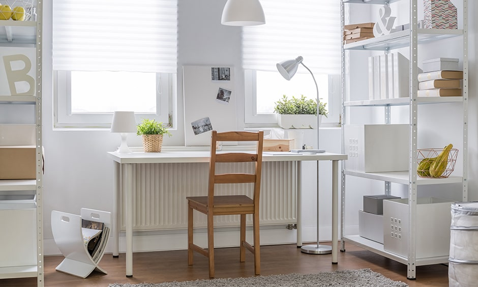 Study table decoration with white furniture and indoor plants in a pot