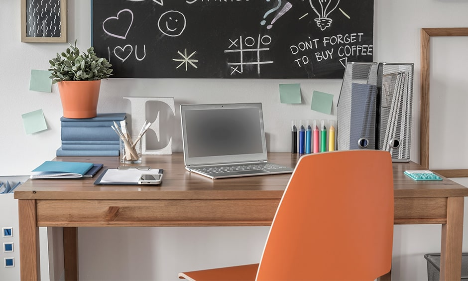 Study table wall decor with an orange chair and wooden study table