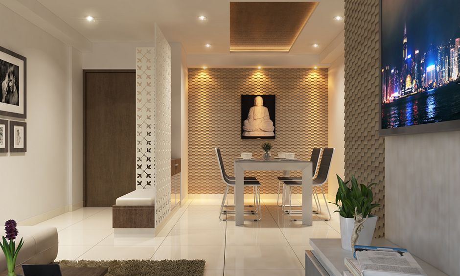Living cum dining area with criss-cross patterned jali partition design is traditional hall dining partition ideas.