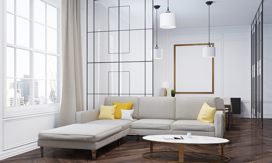 Modern living room in white with patterned glass floor to ceiling hall partition is sophisticated interior design.