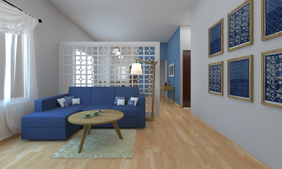 Partition designs in hall with wooden flooring and blue sectioned sofa, an all-white hall stands tall and elegant.
