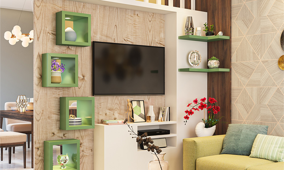 Tv unit with shelves and open cabinets for storage is partition design for living room and dining hall.