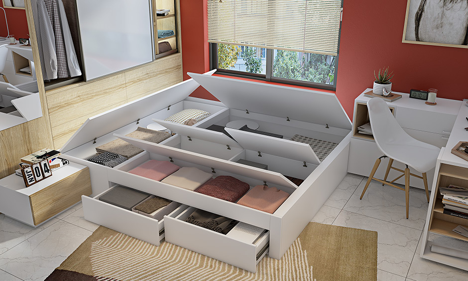 Bed with a great storage option to hide seldom stuffs for clutter-free is space-saving 1bhk interior design ideas